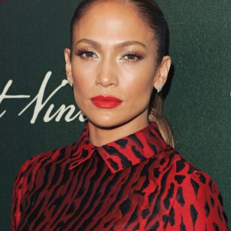 Con labios rojos. Foto:vía Getty Images