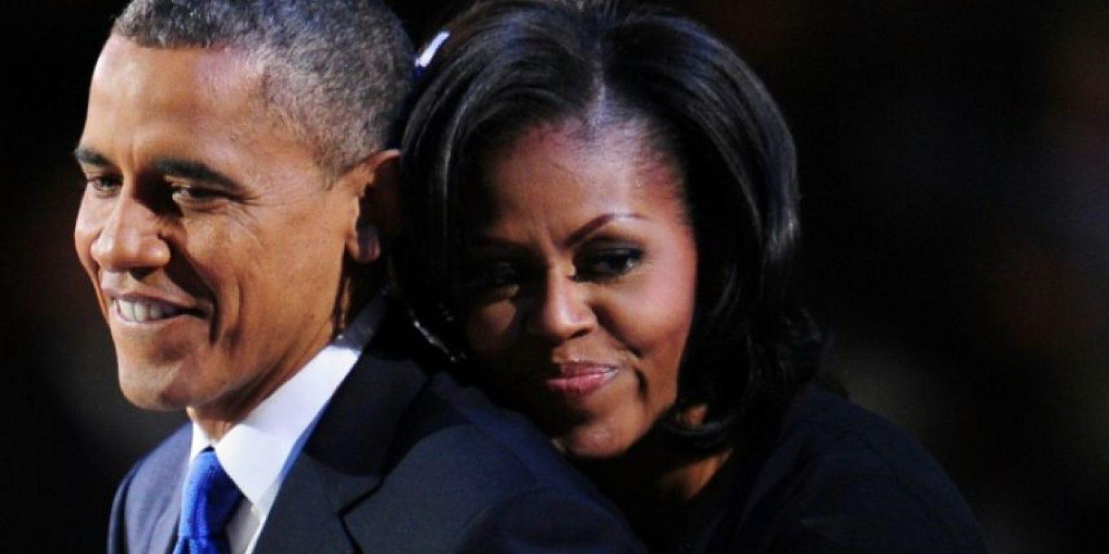 Barack y Michelle Obama se abrazan tras el discursod e aceptación del nuevo presidente de EEUU, el 7 de noviembre de 2012 en Chicago Foto:Robyn Beck/afp.com