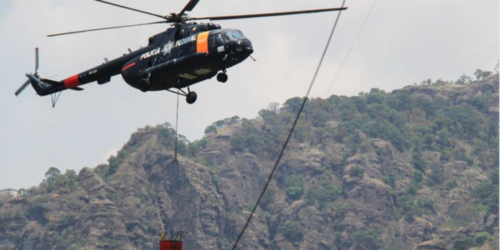 Se 18 descargas de agua con apoyo de los helicópteros del Estado de México, la Secretaría de Marina la Policía Federal. Foto:Cuartoscuro