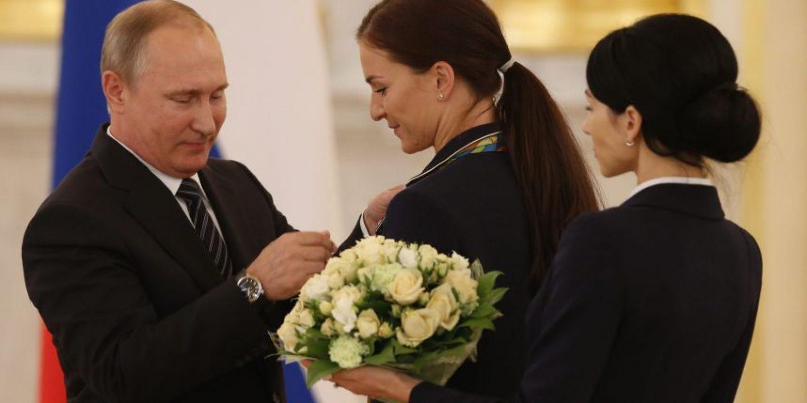 Putin brindó con champán en el Palacio del Kremlin con los medallista Foto:EFE
