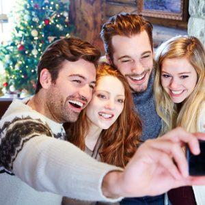Fotografía familiar en Navidad. Foto| Getty
