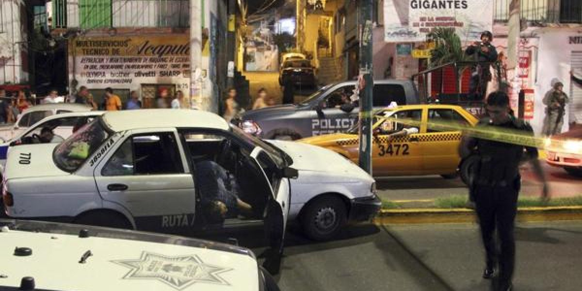 Hallan tres cabezas humanas sobre auto en Acapulco