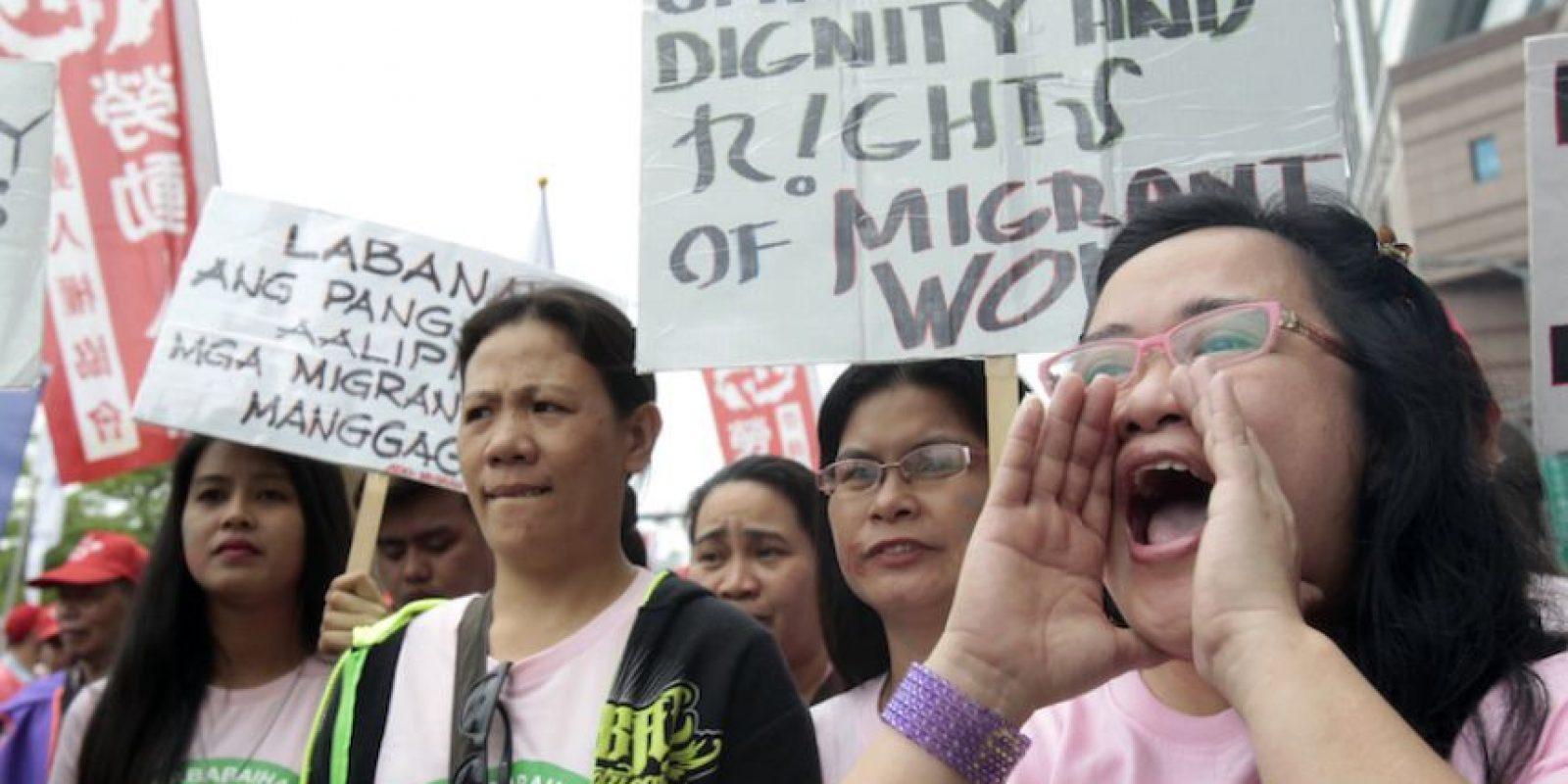 Trabajadores extranjeros en Taiwán corean lemas durante una marcha por el Primero de Mayo en Taipei, Taiwán, el domingo 1 de mayo de 2016. Foto:AP. Imagen Por: