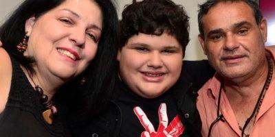 Christopher Rivera junto a sus padres Sandra Soto y Luis Rivera. Foto:Dennis A. Jones. Imagen Por: